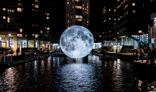 A 23-foot replica of Earth's moon will be raised above Catalano Square in the Historic Third Ward